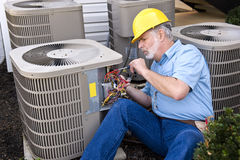 Air Conditioner Repairman At Work Royalty Free Stock Photography