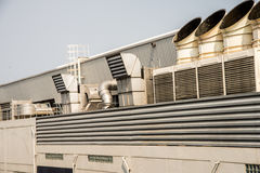 Air conditioner on the roof with blue sky. Air conditioner on the roof with a blue sky Royalty Free Stock Images