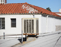 Air Conditioner on Roof. Large old air conditioner sits on a roof top Stock Photography