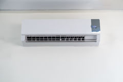 Air conditioner split type embed on wall of living room., Treatment air. Royalty Free Stock Image