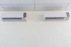 Air conditioner split type embed on wall of living room., Twin a Stock Image