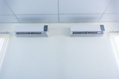 Air conditioner split type embed on wall of living room., Twin a Stock Photo