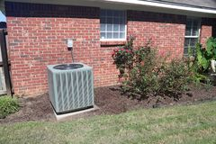 Air Conditioner system next to a home royalty free stock photography