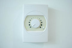 Air conditioner temperature control switch on the wall Royalty Free Stock Photos