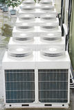 Air Conditioner Unit. Air conditioner condenser unit outside a house Stock Photos
