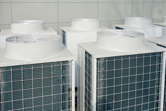 Air Conditioner Unit. Air conditioner condenser unit outside a house Royalty Free Stock Images