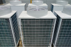 Air Conditioner Unit. Air conditioner condenser unit outside a house Stock Photography