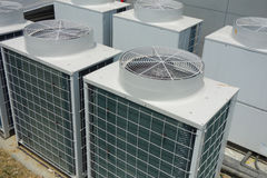 Air Conditioner Unit. Air conditioner condenser unit outside a house Royalty Free Stock Photo