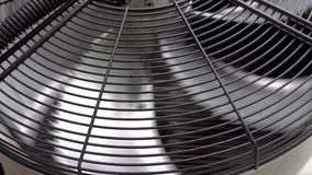 Air conditioner unit fan rotating. Close-up. 4K. Air conditioner unit fan rotating. Close-up. 4K stock video