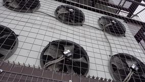 Air conditioner unit fan rotating. Industrial air conditioner unit fan rotating stock video