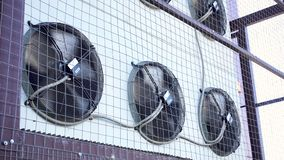 Air conditioner unit fan rotating. Industrial air conditioning system on the wall outdoors stock video footage