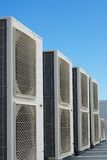 Air conditioner units. On the roof of an industrial building. Blue sky in the background. No people. Copy space Royalty Free Stock Images