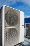 Air conditioner units. On the roof of an industrial building. Blue sky in the background. No people. Copy space Stock Photo