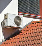 Air conditioner on the wall. Of a house royalty free stock image