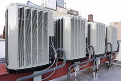 Air Conditioners. A row of air conditioning units on a rooftop Stock Images