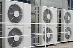 Air conditioners. Row of air conditioners outside of a building Royalty Free Stock Image