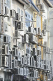 Air conditioners in busy asian city street. Air conditioners on wall of building in busy asian city street stock image