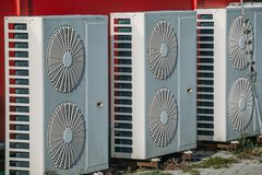 Air conditioners or HVAC or climate control systems on backyard of building. Close up stock photography