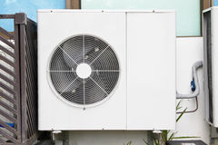 Air conditioners installation outside of building near   glass windows Royalty Free Stock Image