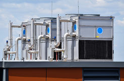 Air conditioners on the top of an office building Stock Image