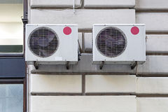 Air conditioners. Two external air conditioner device units Stock Photography
