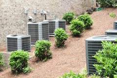 Air Conditioning. Rows of air conditioning units.  Cooling units in a residential area Stock Images