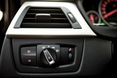 Air conditioning of automobile interior and headlight controls - modern Royalty Free Stock Photography