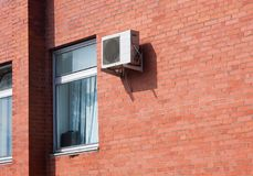 Air Conditioning on a brick wall Royalty Free Stock Photo