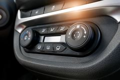 Air conditioning button inside a car. Climate control unit in the new car. Modern car interior details. Car detailing. Selective royalty free stock photo