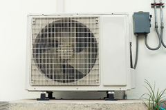 Air conditioning compressor installation outside building., Air. Conditioning system stock photos