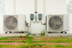 Air conditioning compressor installation outside building., Air Stock Photography