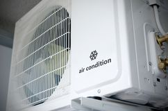 Air conditioning compressor installation outside building with s. Ample logo with snowflake stock photos