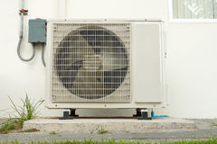 Air conditioning compressor installation outside building. Air conditioning system royalty free stock photo