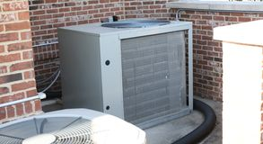 Air conditioning condenser. The condenser unit of residential air conditioning units stock image