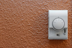 Air conditioning control panel on wall. White air conditioning control panel on wall in a hotel room. Useful file for your energy, hotel, and environmentalism Stock Photo
