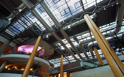 Air conditioning ducts. A view of a mall with Industrial air conditioning ducts and ventilation tubes on the ceiling with wooden pine pillars Stock Photos