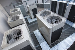 Air conditioning equipment atop a modern building. Aerial/drone view of the roof with all the necessary installations stock photo