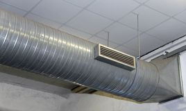 Air conditioning and heating with stainless steel tubing in a wo. Great air conditioning and heating with stainless steel tubing in a workshop Stock Photo