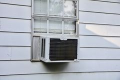 AC Unit in Window Royalty Free Stock Photo