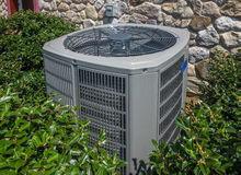 Air conditioning and heating unit for a residential house Royalty Free Stock Images