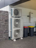 Air conditioning and heating units for a residential house Stock Photos