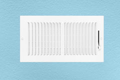 Air conditioning and heating vent on wall stock image