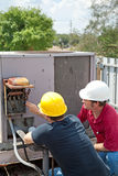 Air Conditioning Repair - Teamwork Royalty Free Stock Image