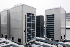 Air conditioning system. Assembled on top of a building, snow weather Stock Photos