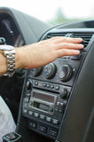 Air conditioning system. Man using automobile air conditioning system Royalty Free Stock Images
