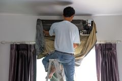 Air conditioning technician cleaning coil cooler air conditioner stock image