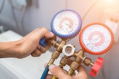 Manometers measuring equipment for filling air conditioners stock photo