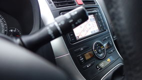 Air conditioning unit, rain sensor levers, clusters, dashboard and big navigation display. Stock Image