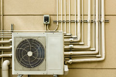 Air conditioning unit sitting outside Royalty Free Stock Image