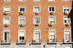 Air Conditioning Units on Building. A uniform series of air conditioning units on a building of flats or offices royalty free stock images